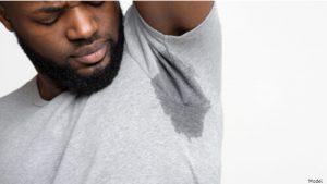 Man wearing gray shirt with sweaty armpits