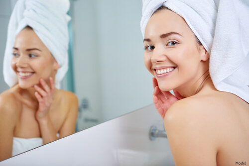 Woman that just got out of the shower with a towel on her head