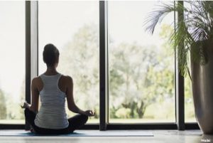 Woman doing yoga in a room